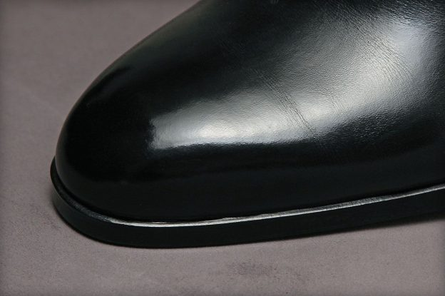 A sewing method used to prevent the soles from extending beyond the contours of the shoes. The thread is hidden deep in the insole.