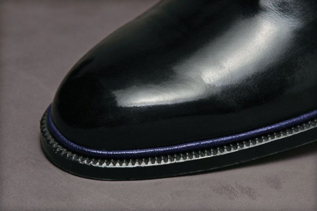The method of construction is basically the same as in welting, but a decorative strip made of calfskin of any desired color is added.